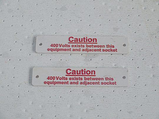 CAUTION 400V Exits Between This Equipment And Adjacent Socket